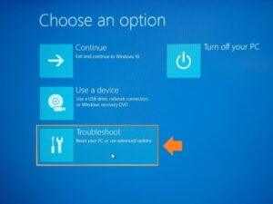 Find Laptop model - Screenshot of Microsoft Boot menu Choose an option. Troubleshoot has been highlighted and arrowed.