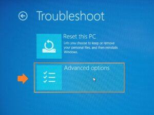 Find Laptop model - Screenshot of Microsoft Boot menu Troubleshoot. Advanced options has been highlighted and arrowed.